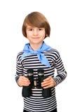 Усмехаясь молодой мальчик с бинокулярным Стоковое Фото