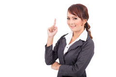 Усмехаясь молодой пункт руки бизнес-леди предложите работу стоковое фото rf