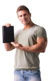 Усмехаясь молодой человек держа и показывая обложку книги Стоковое фото RF