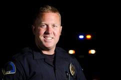 Усмехаясь офицер Стоковое Фото