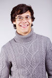 Усмехаясь парень в свитере Стоковые Фото