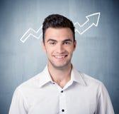 Усмехаясь парень дела с стрелкой диаграммы Стоковое Фото