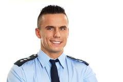 Усмехаясь полицейский Стоковые Изображения