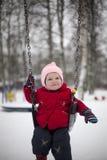 Усмехаясь ребёнок на качаниях Стоковое Изображение RF