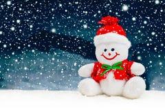 Усмехаясь родовая игрушка снеговика рождества Стоковое фото RF
