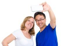 2 усмехаясь друз принимая selfie Стоковое Фото
