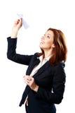 Усмехаясь самолет бумаги коммерсантки бросая Стоковое Фото