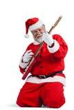 Усмехаясь Санта Клаус играя гитару Стоковые Изображения