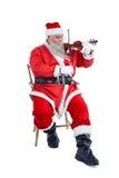 Усмехаясь Санта Клаус играя скрипку Стоковые Изображения RF
