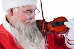 Усмехаясь Санта Клаус играя скрипку Стоковая Фотография RF
