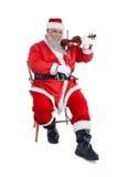 Усмехаясь Санта Клаус играя скрипку Стоковое Фото