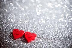 Усмехаясь сердца на ярких блесках Стоковое Изображение