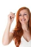 Усмехаясь сочинительство женщины на пустом copyspace Стоковые Фотографии RF