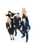 Усмехаясь счастливые предприниматели имея встречу в офисе Показывать t Стоковое Фото