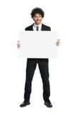 Усмехаясь человек в смокинге проводя плакат Стоковая Фотография RF