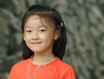 усмешка китайца ребенка Стоковая Фотография