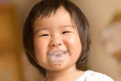 усмешка младенца Азии Стоковые Изображения RF