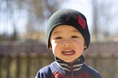 усмешка младенца милая Стоковое Изображение