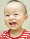 усмешка младенца Стоковая Фотография