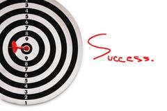 Успех и красный дротик на цели Стоковые Изображения