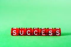 Успех, красный на зеленом цвете Стоковое фото RF
