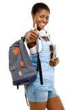Успешная Афро-американская женщина студента идя назад к школе i стоковые фотографии rf