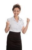 Успешная коммерсантка - скачущ для утехи при изолированные кулаки Стоковые Изображения