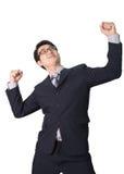 Успешное счастливое ликование бизнесмена поднимая его сторону к s Стоковое Фото