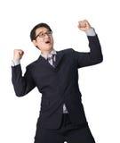 Успешное счастливое ликование бизнесмена поднимая его сторону к s Стоковое Изображение