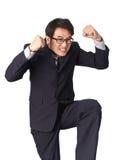 Успешное счастливое ликование бизнесмена поднимая его сторону к s Стоковые Изображения