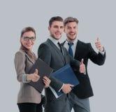 Успешные бизнесмены смотря счастливый и уверенно Стоковое Изображение
