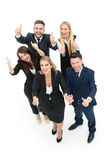 Успешные бизнесмены смотря счастливый и уверенно показ Стоковое Фото