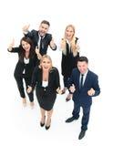 Успешные бизнесмены смотря счастливый и уверенно показ Стоковая Фотография