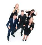 Успешные бизнесмены смотря счастливый и уверенно показ Стоковые Фотографии RF