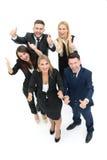 Успешные бизнесмены смотря счастливый и уверенно показ Стоковые Изображения RF
