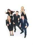 Успешные бизнесмены смотря счастливый и уверенно показ Стоковое фото RF