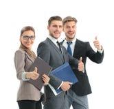 Успешные бизнесмены смотря счастливый и уверенно Стоковое Фото