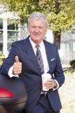 Успешные большие пальцы руки бизнесмена вверх Стоковое Изображение
