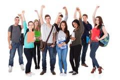 Успешные студенты университета над белой предпосылкой стоковое изображение rf