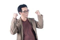 Успешный бизнесмен пробивая воздух с его кулаками в воздухе, s Стоковое Изображение
