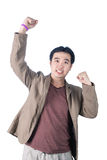 Успешный бизнесмен пробивая воздух с его кулаками в воздухе, s Стоковое Фото