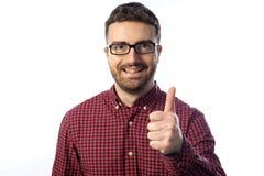 Успешный большой палец руки молодого человека вверх Стоковое фото RF