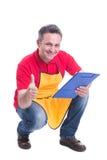 Успешный продавец показывает как знак и усмехаться Стоковое Фото