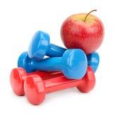 Установите гантели и яблоко Стоковые Изображения