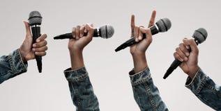 Установите микрофона удерживания руки стоковые фото