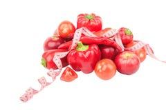 Установите от красного перца, накаленного докрасна перца chili и яблок, изолированного на белизне Стоковая Фотография RF