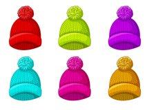 Установите пестротканой шляпы зимы с pompom стоковая фотография rf