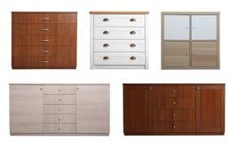 Установите различных стильных commodes на белизне Мебель для шкафа стоковая фотография rf
