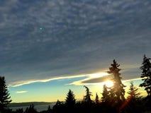 Установка Солнця за облаками Стоковое Фото