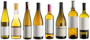 Установленные бутылки белого вина Стоковая Фотография